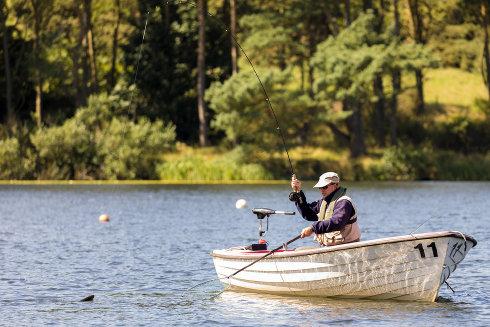 Secretary Bob Whyte landing a fish at Coldingham Loch